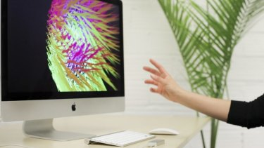 Swipe: A user controls an object on screen with Leap Motion.