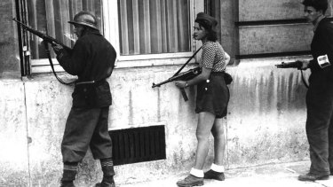 A female member of the French Resistance, August 28, 1944.