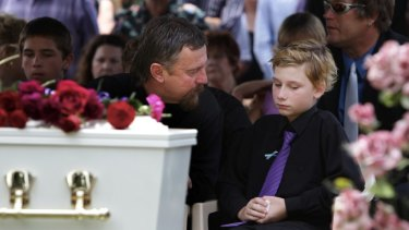 Jordan's father John and the brother he saved, Blake, at the teenager's funeral.