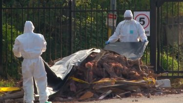 An emergency HAZMAT crew respond to dumped building material found on a Sydney suburban back street in May.