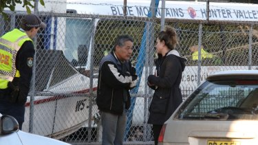 Police interview the landlord Masaaki Imaeda.