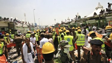 Emergency workers and pilgrims to Mecca gather around those crushed in the stampede in Mina, Saudi Arabia.