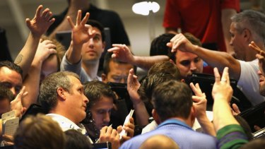 Traders signal offers in the Standard & Poor's 500 stock index options pit at the Chicago Board Options Exchange .