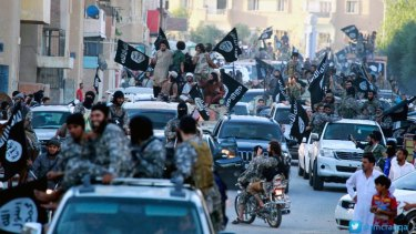 Islamic State fighters parade in Raqqa, Syria.