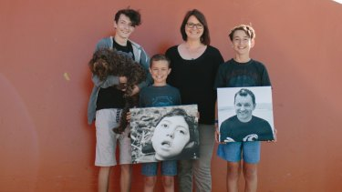 The Kings: Jalen, Milly (the dog), Kobe, Lisa and Harrison with pictures of Noah and Aaron