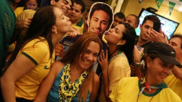 Home favourite: Neymar has become the face of the tournament.