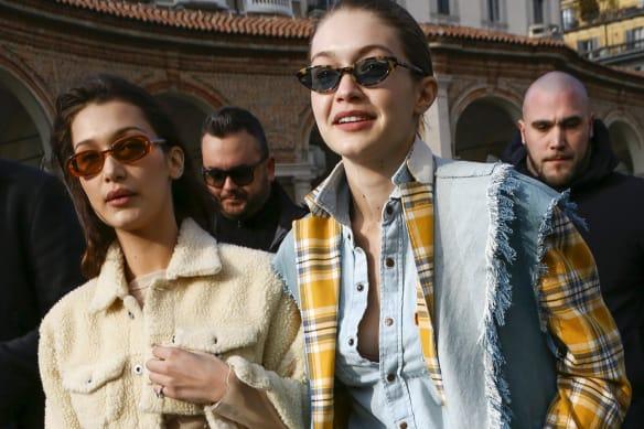 Bella Hadid and Gigi Hadid are arriving to the fashion show of Alberta Ferretti held in La Rotonda della Besana.