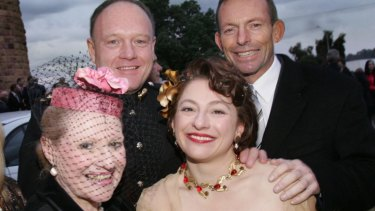 Bronwyn Bishop at the wedding of Sophie Mirabella, with Prime Minister Tony Abbott and another wedding guest, in 2006.