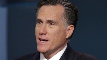 "Mitt Romney has criticised Donald Trump, calling him a ""fraud""."
