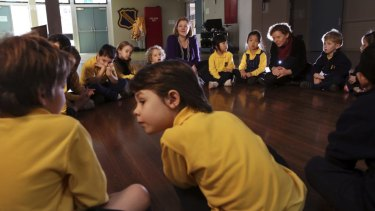 Ethics teachers Jane Morris and Carol Connolly talk with kindergarten students at Haberfield Public School.