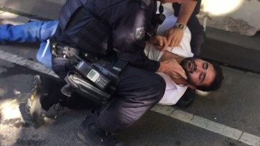 Police arrest a man who was in the Suzuki Vitara that mowed down CBD pedestrians.