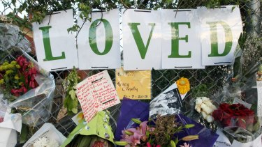 Tributes to Ms Connelly were tied to a fence near where she was killed.