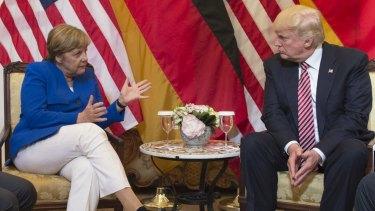 German Chancellor Angela Merkel and US President  Donald Trump meet at the G7 summit.