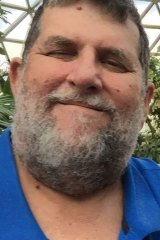Brisbane cab company owner Greg Collins, a 30-year taxi industry veteran who admitted in a social media post to bashing an Uber driver.