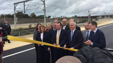 """It's my ribbon"". 13 state and federal MP's get giddy about the opening of a road."