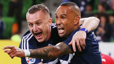 Besart Berisha and Archie Thompson.