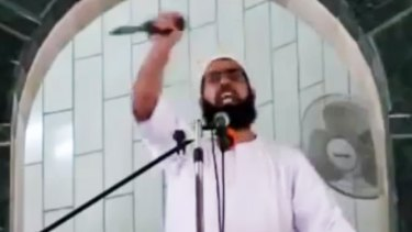 Muhammad Sallah brandishes a knife during a Friday sermon at al-Abrar mosque in the Gaza Strip town of Rafah on October 9.