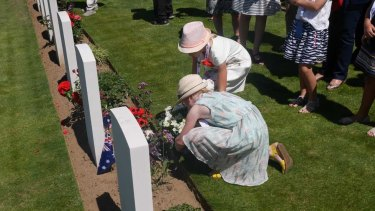 Australians lay flowers in memory of those lost at Fromelles.