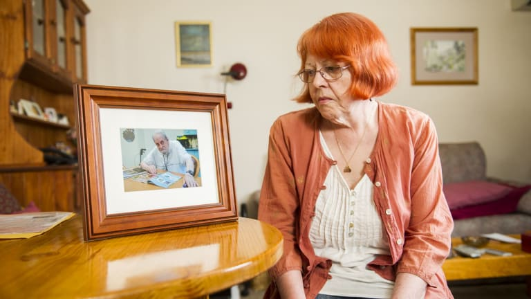 Unhappy daughter: Kambah resident Moira Smith looks at a photo of her father Douglas who died recently.