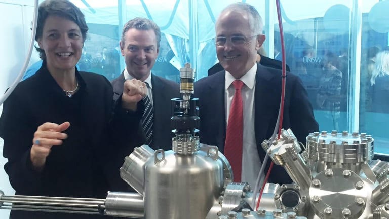 Professor Michelle Simmons explains the operation of a new scanning tunnelling microscope to Prime Minister Malcolm Turnbull (right) and the then Minister for Science, Christopher Pyne.