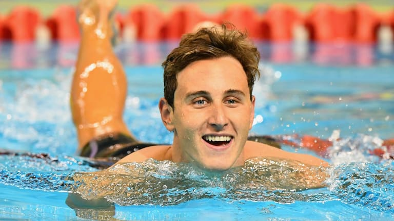 Fantastic form: Cameron McEvoy celebrates winning the 50-metre freestyle.