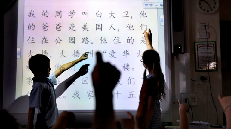 Year three students learning Mandarin in a multilingual lesson.