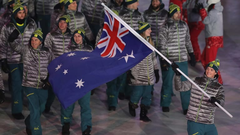 Proud moment: Scotty James carries the Australian flag into the arena.