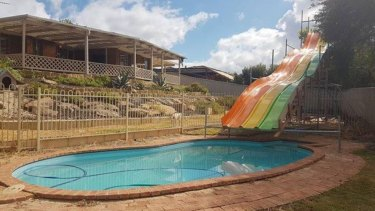 The makeshift pool slide.