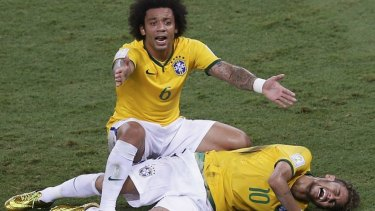 Panic: Marcelo gestures over his injured teammate Neymar.