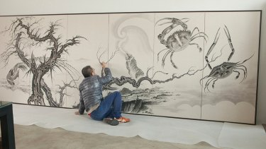 Sun Xun working on Invisible Magic (2018) at the Museum of Contemporary Art Australia.