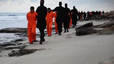 Men purported to be Egyptian Christians held captive by the Islamic State are marched by armed men in this still image from the video.
