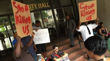 Protesters gather at City Hall in Baton Rouge over the shooting of Alton Sterling on Wednesday.