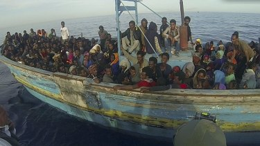 Migrants sit in their boat during a rescue operation off the coast of Sicily earlier this month.