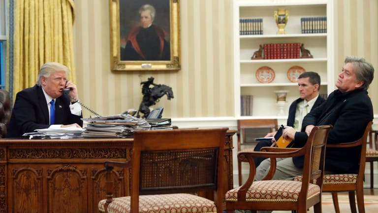 Donald Trump with Mike Flynn and Steve Bannon in the Oval Office during the call to Malcolm Turnbull.
