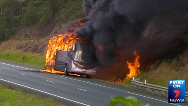 A school bus burns in the northbound lane of the Bruce Highway near Sippy Downs, north of Brisbane.