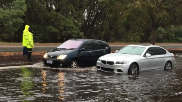 A BMW trapped in flood waters in Osborne Park on Friday morning.