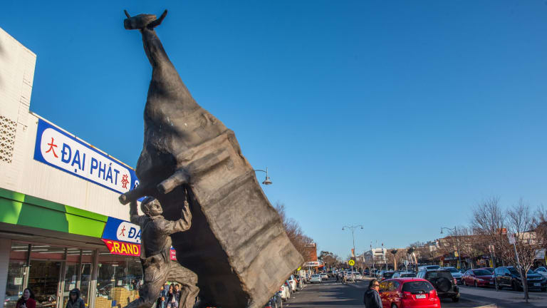 John Kelly's sculpture Man Lifting Cow.