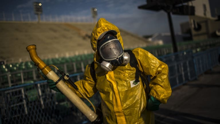 A worker fumigates the Sambadrome ahead of Carnival celebrations in Rio de Janeiro.