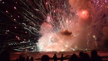 Crowds have been evacuated from Terrigal Beach, after a barge carrying fireworks caught alight during their 9pm show.