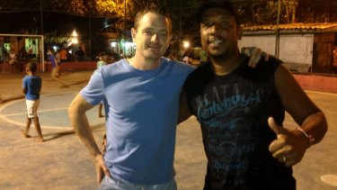 Love of the game: Conor Hartnett and Carlao in the favela.