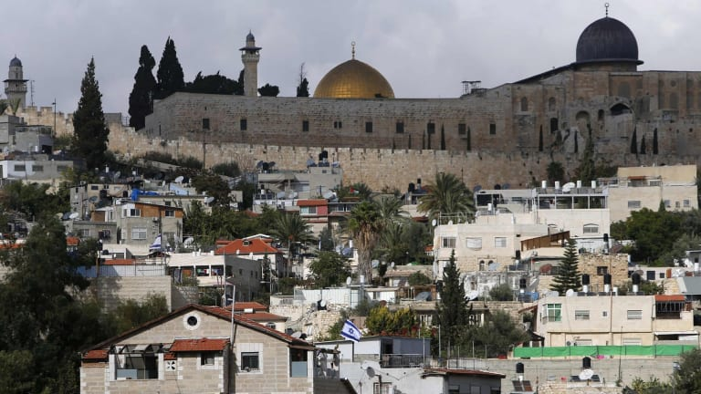 Flashpoint: The golden Dome of the Rock and to its right the dome of the al-Aqsa mosque are seen from the occupied East Jerusalem neighbourhood of Silwan.
