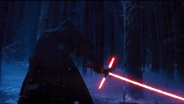 Revenge of the Sith Lords? A figure cloaked in black holds a new lightsaber.