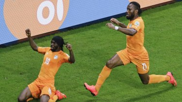 vory Coast's Gervinho, left, celebrates with his teammate Didier Drogba.