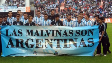 "Still a sore point: Argentina's team posing for a picture with a banner reading ""The Malvinas are Argentine""."