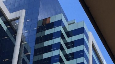 A panel fell from the Allianz Centre in Sydney's CBD, witnesses say.