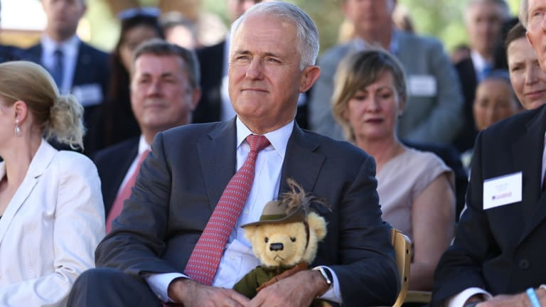 Prime Minister Malcolm Turnbull holds Trooper Jones, the light horse fundraising bear, during a visit to Soldier On in Canberra on Friday.