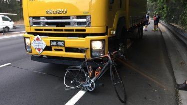 A damaged bike appeared to be wedged under the truck that hit the riders.