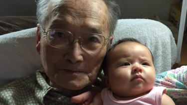 Wang Chunming, 91, with grandaughter Isla Turnbull, born in May. Isla is the daughter of Alex Turnbull and Yvonne Wang, and granddaughter of Prime Minister Malcolm Turnbull