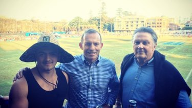 A fan meets Tony Abbott and his former campaign manager Ian Macdonald.