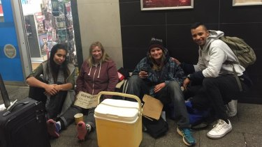 Siham and Mirwan Carollisen (far right and far left) helping the homeless in Northbridge earlier this year.